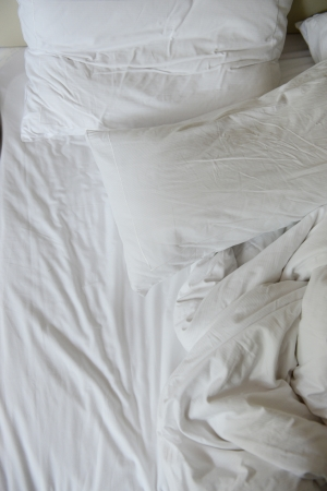 close up of messy bedding sheets and pillow Stock Photo - 15137069
