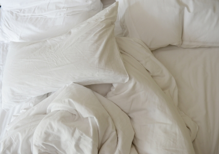 unattended: close up of messy bedding sheets and pillow