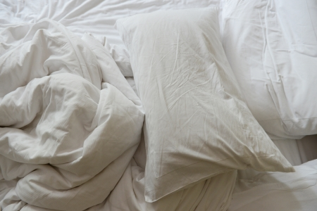 bed sheet: close up of messy bedding sheets and pillow