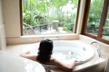 young woman in bathtub with a beautiful view outside the window Stock Photo - 15137067