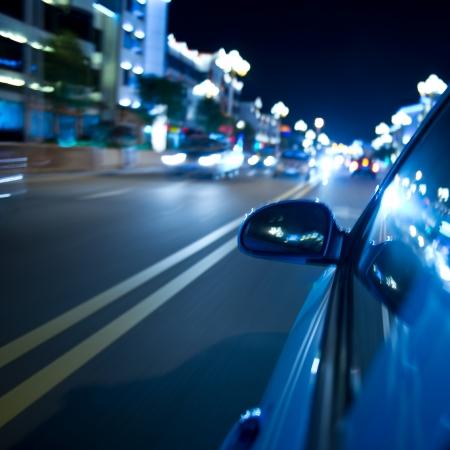 street racing: night drive ,shoot from the window of speed car, motion blur steet light.