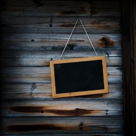 Blackboard on the wood wall.  Stock Photo - 15302927