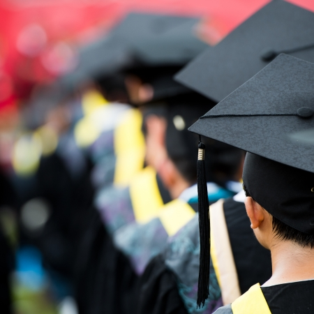 mba: back of graduates during commencement.  Stock Photo