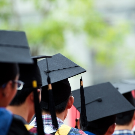 green back: back of graduates during commencement.  Stock Photo