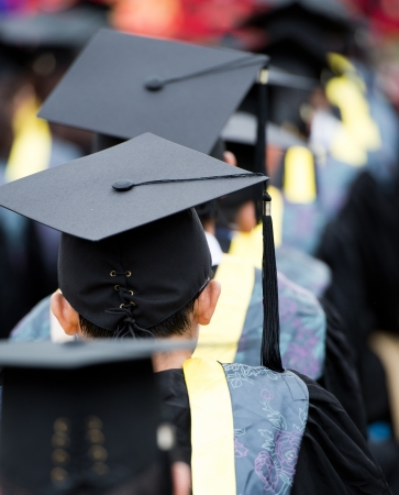 commencement: back of graduates during commencement.  Stock Photo