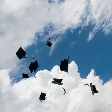 Mortarboards  in the air at graduation. photo