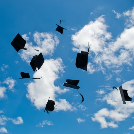 hurl: Mortarboards  in the air at graduation. Stock Photo