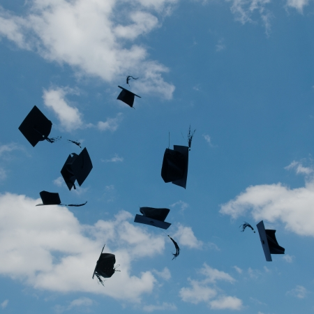toss: Mortarboards  in the air at graduation. Stock Photo