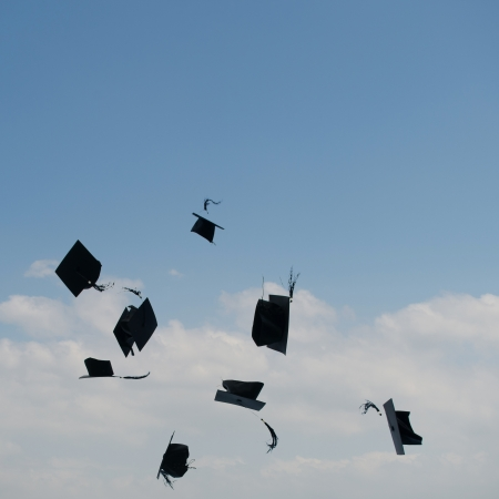 Mortarboards  in the air at graduation. Stock Photo