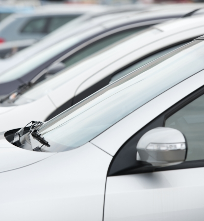 many cars parked in a row.  Stock Photo - 16500940