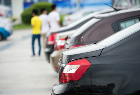 show window: many cars parked in a row.  Stock Photo