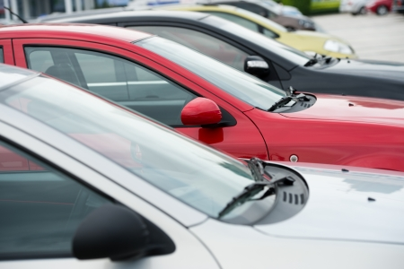 car lot: many cars parked in a row.  Stock Photo
