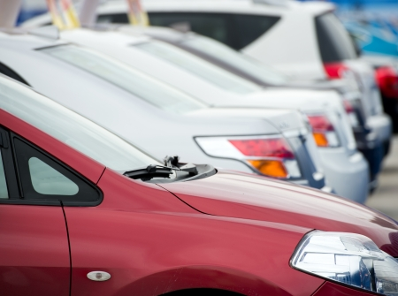 new motor vehicles: many cars parked in a row.  Stock Photo