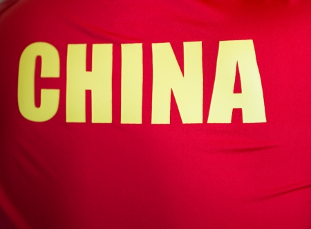 crimped: word  CHINA on the back of a chinese athlete.