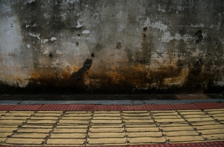 grunge concrete wall with tile floor. Stock Photo - 16503362