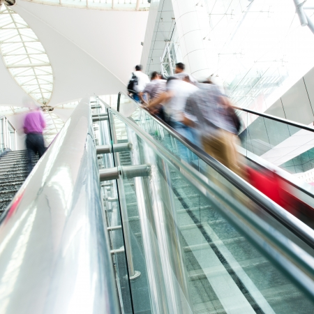 People rush on escalator motion blurred. shopping abstract. Stock Photo - 16506761
