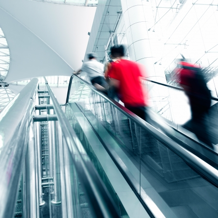 People rush on escalator motion blurred. shopping abstract.