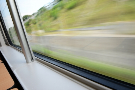 a blurred window view from a train in motion  photo
