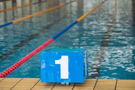 Competition swimming pool with starting blocks  photo