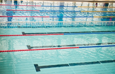 swiming: empty swimming pool with many lanes.