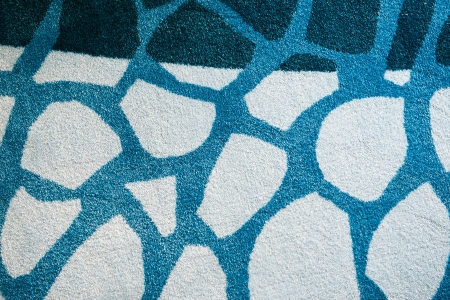 a woolen blue carpet with a relief pattern  photo