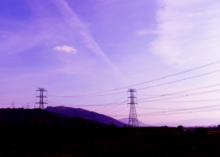 outdoor electricity: high voltage post at sunset.