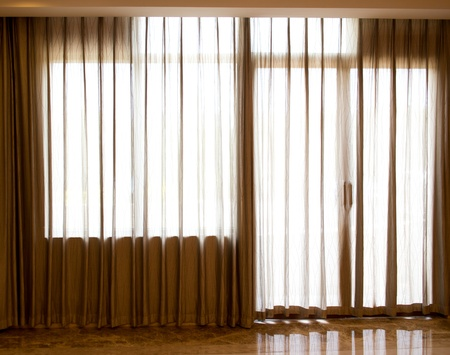 Luxury curtain in front of glass door and windows. Stock Photo - 17415174
