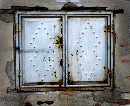 Decorative metal window on an old concrete wall. Stock Photo - 17575343