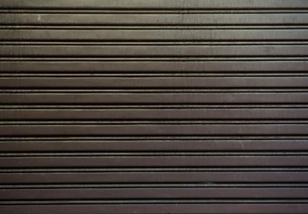 shutter door: Texture of metal door surface.