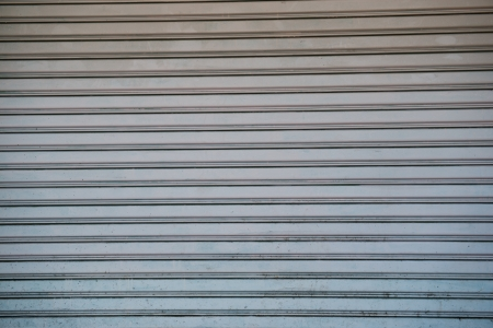 Texture of a metal roller shutter door .  photo