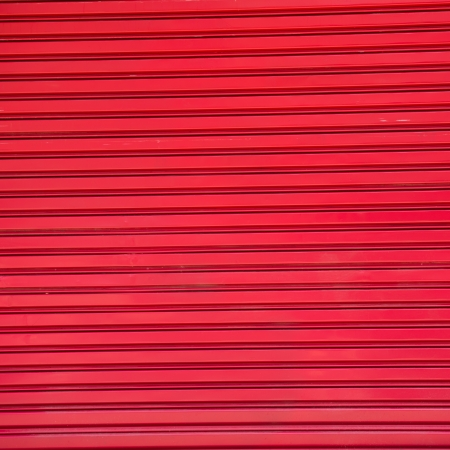 corrugated steel: Texture of metal door surface.