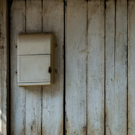 detail of old wooden door with mailbox. photo