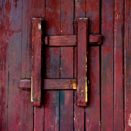 old red barn: Old style wooden door closed.