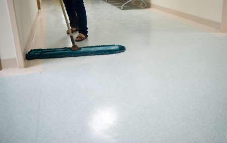 mopping: People cleaning floor in office building lobby