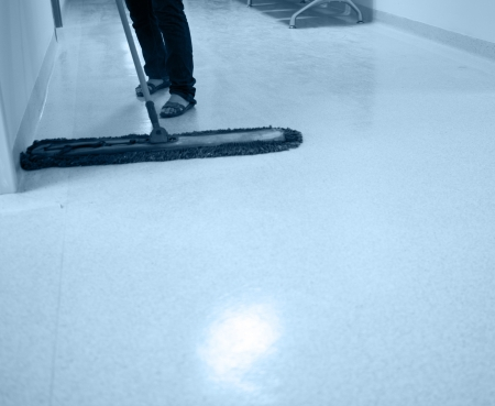 buffing: People cleaning floor in office building lobby