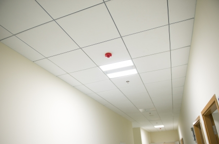 office ceiling: Lights from ceiling of business building.