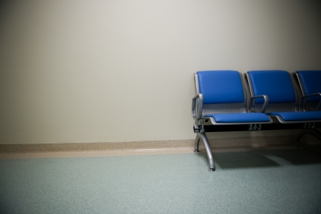 waiting area: empty seats at a business building against  wall