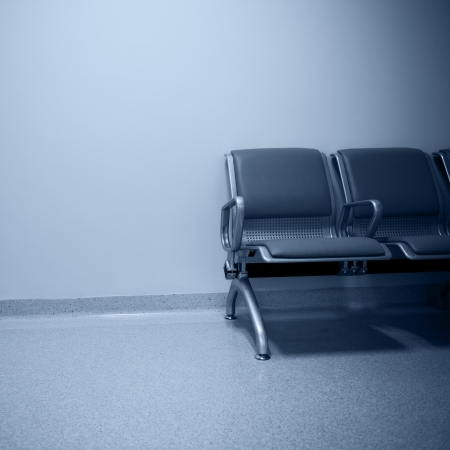 empty seats at a business building against  wall  photo