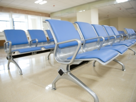 hospital waiting room with empty chairs photo
