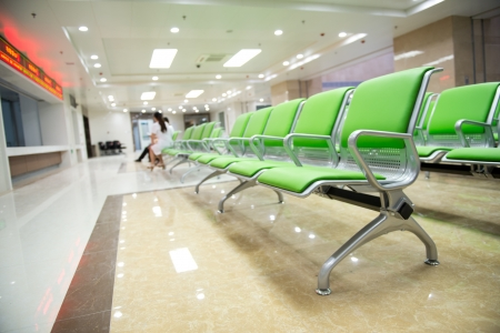 Hospital waiting room with empty chairs. Stock fotó