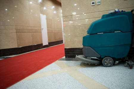 dirty carpet: cleaning machine in the corner of modern office building lobby.