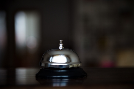 reception desk: Service bell at an hotel table.