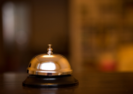bellhop: Service bell at an hotel table.