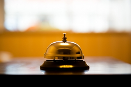 porter: Service bell at an hotel table.