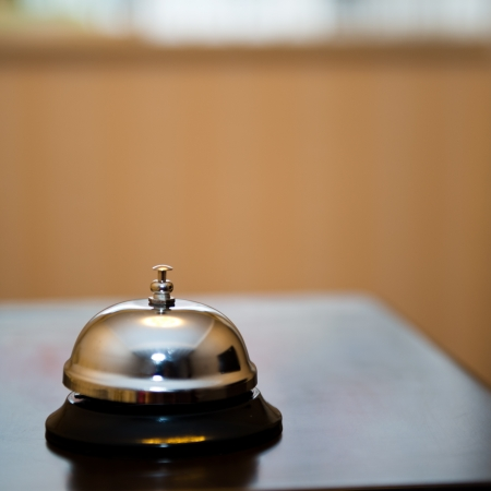 accommodation: Service bell at an hotel table.