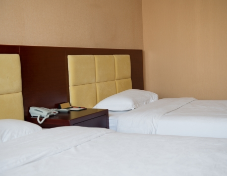 double bed: Two beds bedroom in a hotel room.