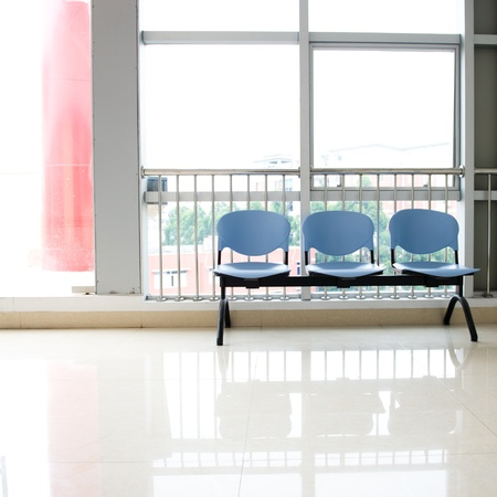 Chairs in the hospital hallway. hospital interior photo