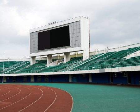 seats and score board in stadium.