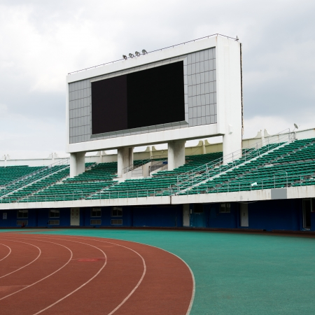 grandstand: seats and score board in stadium. Editorial