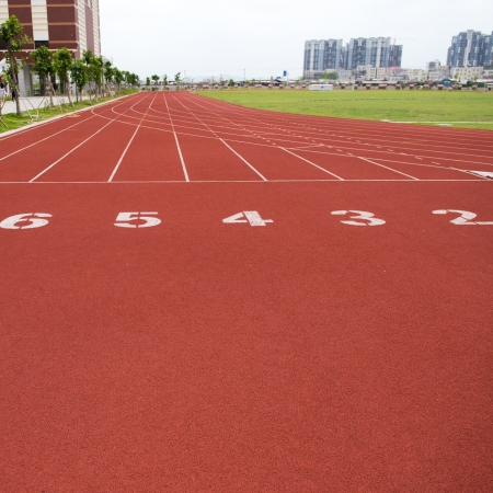 jogging track: Red treadmill at the stadium with the numbers Stock Photo